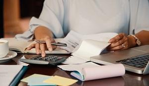 Entrepreneur working with bills
